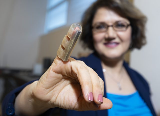 KSU Prof. Simin Nasseri demonstrates new finger support system