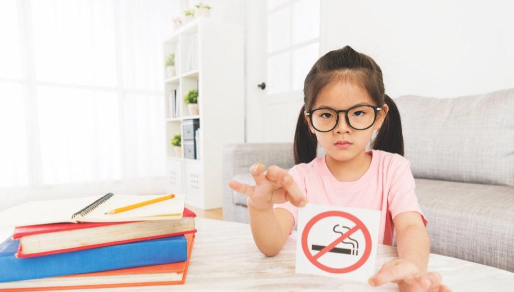 beauty girl kid showing no smoking sign to camera