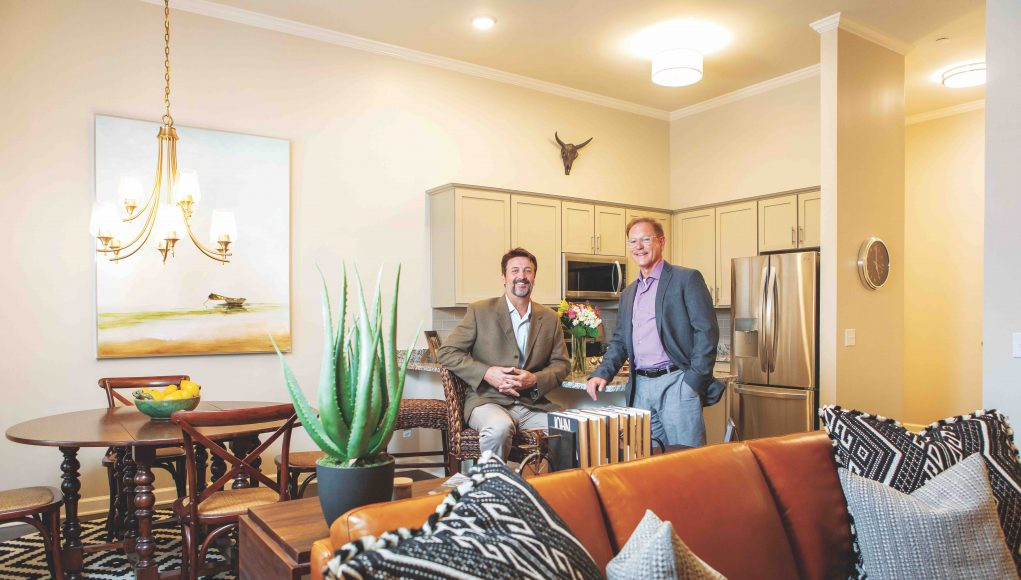 Al Holbrook (right) and Dan Needle, inside one of the homes in the new Holbrook Life Acworth development.
