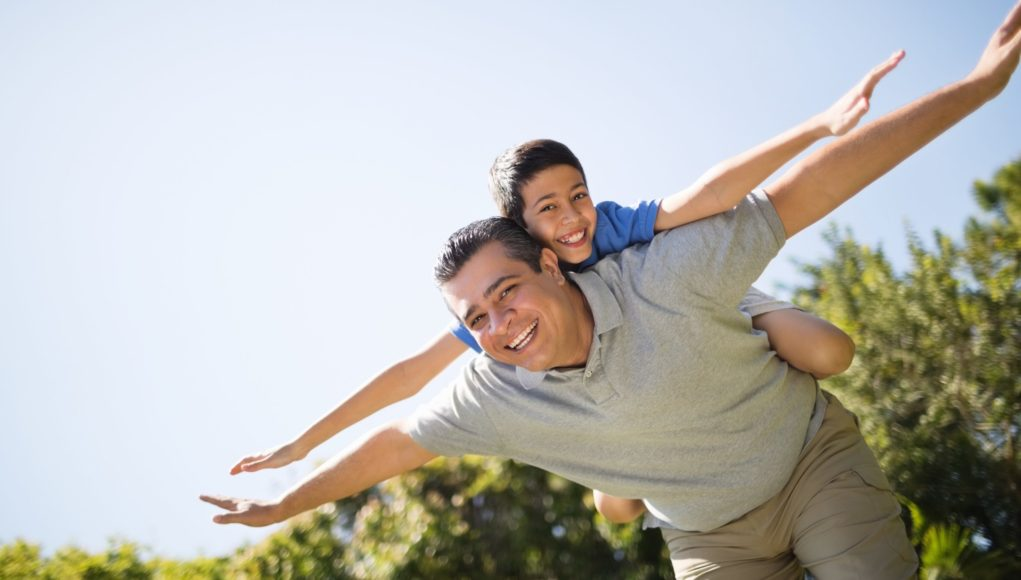 Father Giving Piggyback Ride To Son