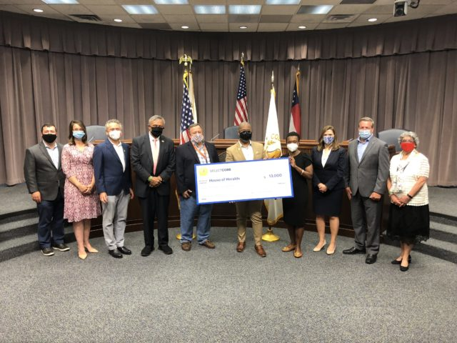 Cobb County Board of Commission members present grant funds to local business House of Heralds.