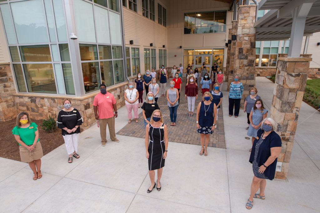 Whitefield Academy staff and faculty outside the new Brostrand Hall.