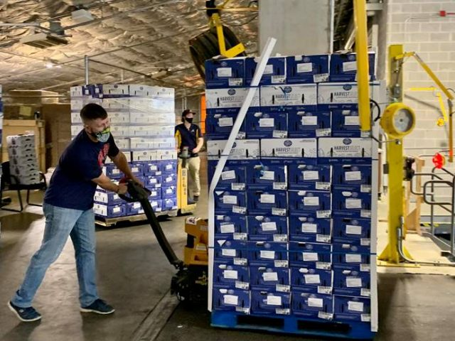 Tyler Holley of the Atlanta Braves Foundation unloading food for the Fleet to be refrigerated prior to pick-up at Truist Park.